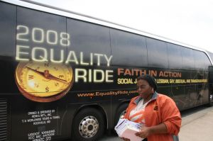 Taueret Manu, an Equality Rider from the Bronx, prepares literature for the stop at Liberty University