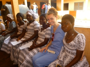 Lindsay at clinic with four girls on the way to their father's funeral.