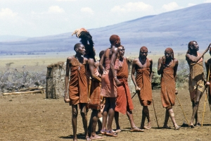 Maasai Mara group standing in village setting