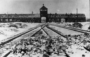 snowy railroad gates of Auschwitz concentration camp