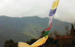 prayer flags blowing in breeze in Nepal mountains
